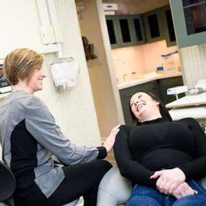patient getting a dental cleaning with a hygienist