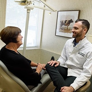 Dr. Turnwald talking to a patient about her oral health and making her feel comfortable.