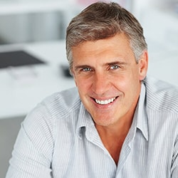 A smiling man with a beautiful smile, thanks to cosmetic dentistry