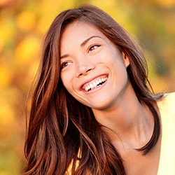 A smiling woman because of Invisalign in Schaumburg IL